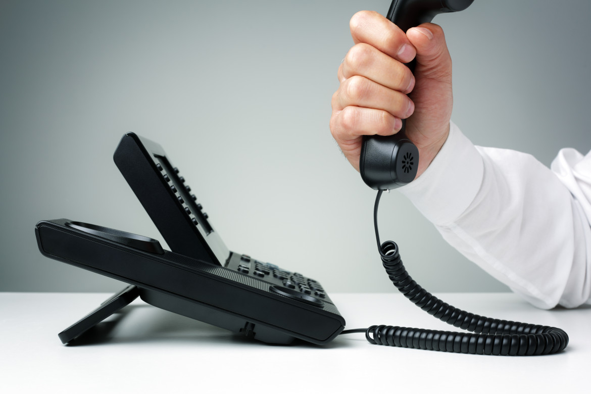 businessman on business landline telephone in an office concept